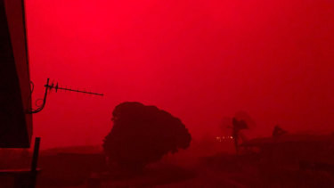The red sky in Mallacoota as the fire hit the town on Tuesday.