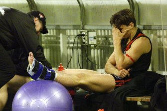 Matthew Lloyd on the bench at quarter time and out of the match with an injured ankle.
