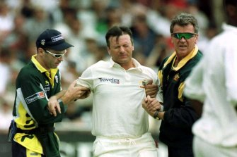 Steve Waugh being helped from the ground at Trent Bridge in 2001.