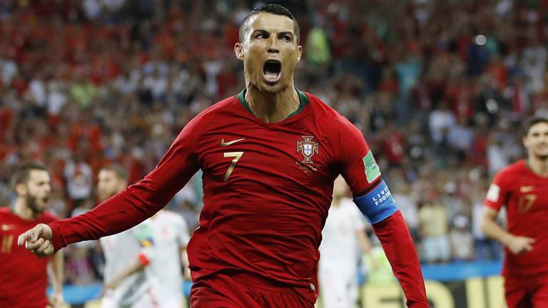Cristiano Ronaldo celebrates Portugal's opening goal.