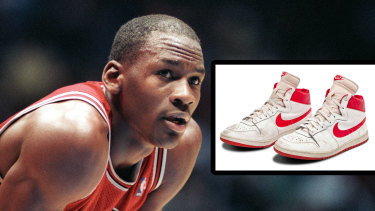 Michael Jordan and the trainers he wore in his fifth NBA game.
