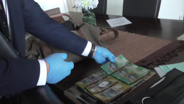 Cash found at former Metro manager Peter Bollas' premises on 19 August totalling approximately $55,000
