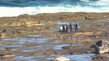 Three men died after their boat crashed into rocks at La Perouse.