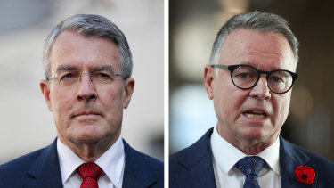 "Mark Dreyfus, left, says his Labor colleague Joel Fitzgibbon's views on climate change are ""out of touch""."