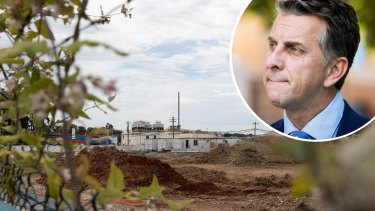 The land at 6 Grand Avenue in Camellia, and Transport Minister Andrew Constance.