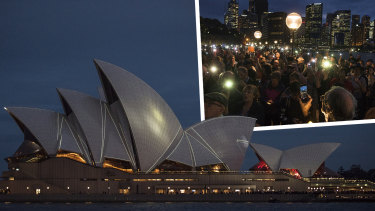 Protesters on the harbour foreshore opposing the projection of material, promoting the 2018 Everest Horse Race onto the sails of the Opera House.