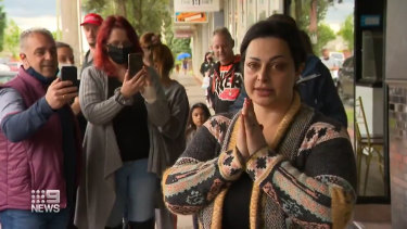 Jomana Najem speaking outside her Hughesdale salon on Saturday.