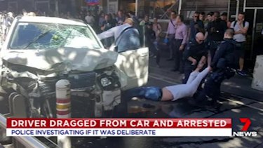 Police drag Saeed Noori from his car after the Flinders Street incident in December 2017.
