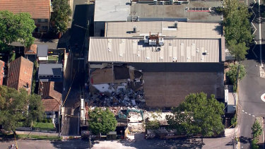 Workers were evacuated before a large part of a commercial building in Crows Nest collapsed on Monday afternoon.