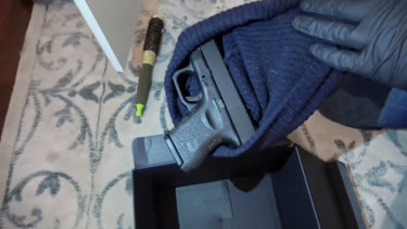 The Glock pistol found inside a black beanie, inside a black box at the bottom of Sarah Budge's wardrobe.