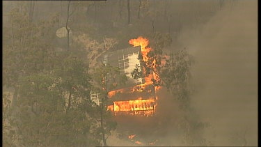 A building burns near the Hawkesbury River on Wednesday.