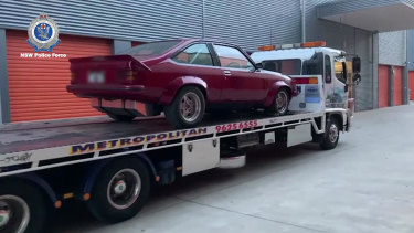 Two classic cars were seized during the raids.