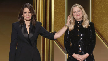 Golden Globes hosts Tina Fey and Amy Poehler in a slightly stretchy two-city link.