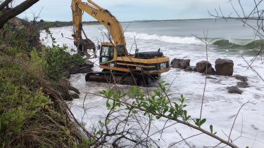 A rock wall being built to try and halt erosion at the beach in Inverloch.