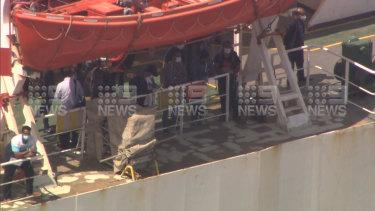 Crew members disembarking the Al Messilah.
