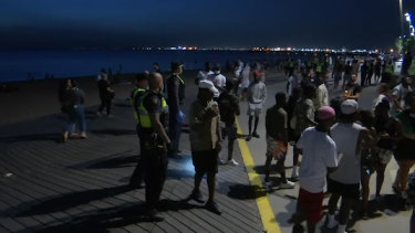 Crowds of young people at St Kilda beach on Sunday night.