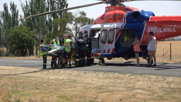The injured boy is loaded into air ambulance.