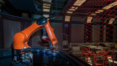 The robotic arm tenders drinks at Prague's new Cyberdog bar.
