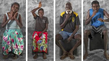 Traditional ways: Daisy Burarrwanga signs djulngi (dear, good, fine, nice); Sheridan Bukulatjpi signs djiwarr (above, sky, heaven);  Fred Djamarrandji signs wanga (speak); and Michael Ganambarr signs marandjalk (stingray).