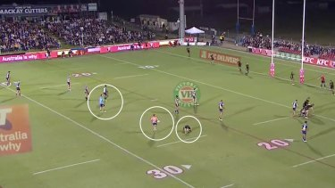 Two Parramatta trainers (circled) are the only trainers on the field seconds before time was called off for Mitch Kenny (circled right).