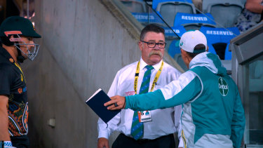 Langer vents his frustration with match referee David Boon at Manuka Oval during a T20 international between Australia and India.