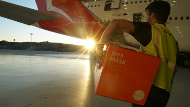 Donated face masks being loaded on to a Qantas plane at Los Angeles airport. The plane arrived in Melbourne on Wednesday ahead of deteriorating weather conditions forecast for Friday.
