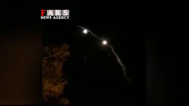 Iran state TV showing a missile attack on a US base.
