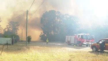 Fire rages around Kearsley in the NSW Hunter Region on Saturday.