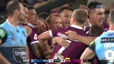 The Maroons celebrate after winning game one in Adelaide after referee Gerard Sutton blew full-time before the siren sounded.