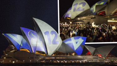 Protesters oppose the projection of material promoting The Everest horse race onto the sails of the Opera House on Tuesday night.