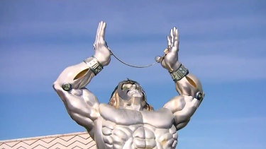 The iconic Millennium Man statue with the chrome globe removed.