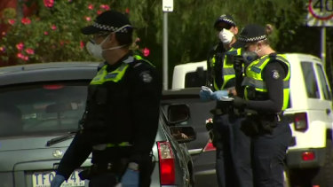 Victoria Police issuing COVID-19 fines in Preston during a refugee protest last month.