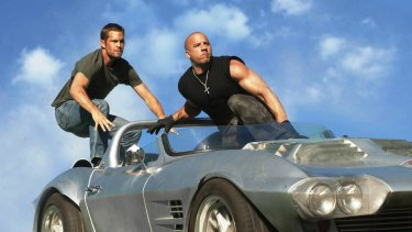 Paul Walker and Vin Diesel in a scene from Fast & Furious 5, also known as Fast Five.