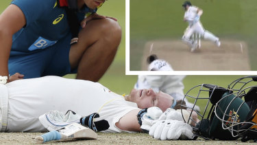 Australia's Steve Smith receives treatment as lies on the ground after being hit on the head by a ball bowled b England's Jofra Archer.