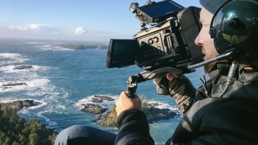 A Blackmagic camera in use during filming of a documentary.