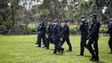 Police march through Elsternwick Park on Saturday