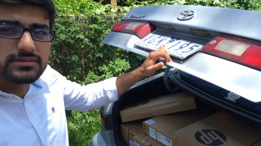 "Vocational education salesman ""Hamza"" with a car boot load of laptops at a housing commission street in Queensland in 2015."
