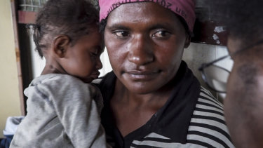 Sabeth Phillip and her malnourished child, Israel, at a health clinic in the remote highlands of Papua New Guinea.