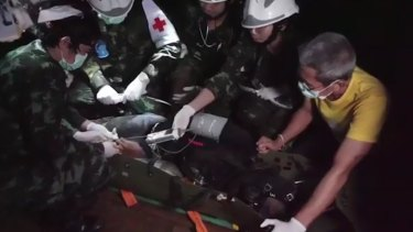 The Tham Luang rescue is captured in a still from a video recorded by Thai Navy SEALs.