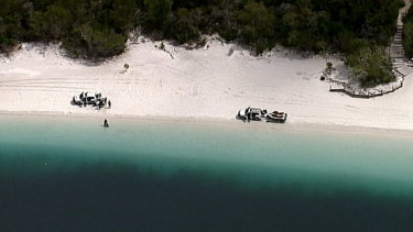 Two teenagers have drowned in Lake McKenzie on Queensland's Fraser Island.