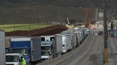 Trucks line up along the US-Mexico border. Donald Trump has threatened to impose tariffs on all Mexican goods if its neighbour doesn't stem the flow of migrants into the US.