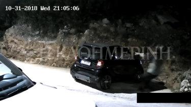 The killer can be seen firing three shots from a handgun into the car.