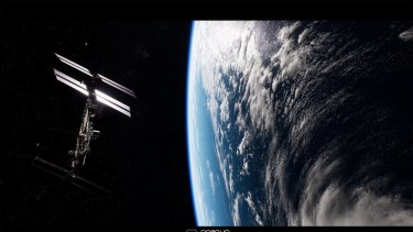 The ISS hangs above the Earth, in virtual space.