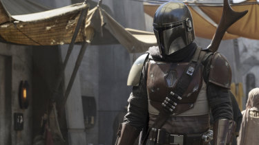 "The battle begins ... Disney+'s The Mandalorian takes aim in the ""streaming wars""."