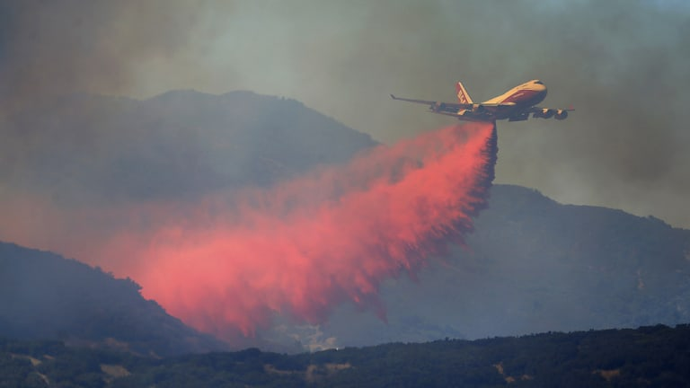 A 747 Global air tanker makes a drop on a wildfire in Scotts Valley on Friday.