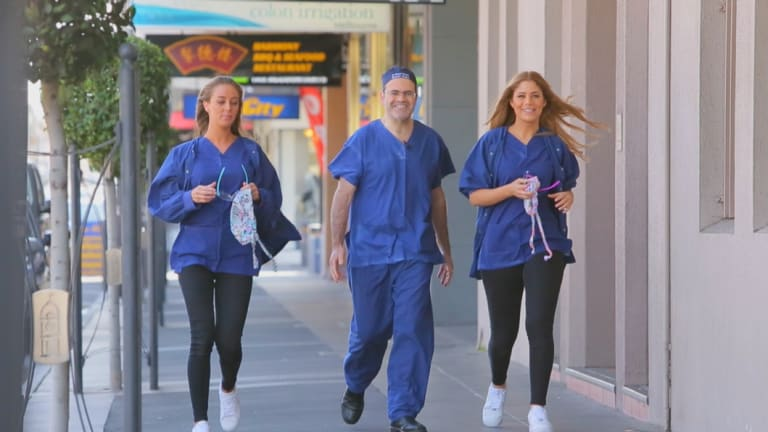 Cosmetic surgeon Daniel Lanzer, with two nurses from his clinic.