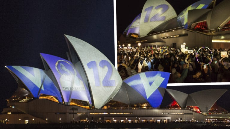 Protesters on the harbour foreshore opposing the projection of material promoting The Everest horse race onto the sails of the Opera House.