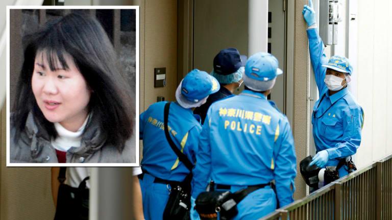 Police investigators head to the house of suspect Ayumi Kuboki in Yokohama.