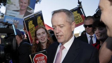 Adani protestors direct chants to Opposition Leader Bill Shorten during the federal election campaign
