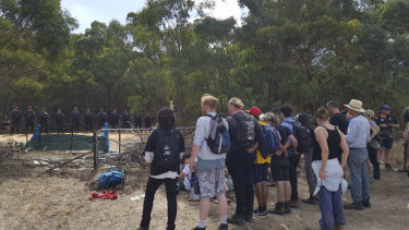 Protesters and police face-off near the Western Highway as environmental and Indigenous activists fight to save 'sacred' trees slated for removal as part of a major highway upgrade.